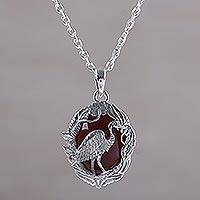 Carnelian pendant necklace, 'Heron Haven' - Carnelian and Sterling Silver Heron Necklace from Bali