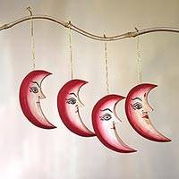 Wood ornaments, 'Moonlight Face' (set of 4) - Set of Four Painted Wood Crescent Moon Ornaments from Bali