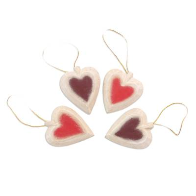 Wood ornaments, 'Ruby Hearts' (set of 4) - Set of Four Painted Wood Heart Ornaments from Bali