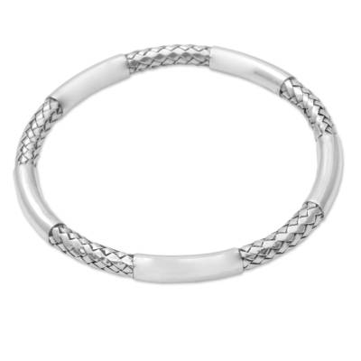 Sterling silver bangle bracelet, 'Bali Show' - Sterling Silver Woven Motif Bangle Bracelet by Bali Artisans