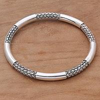 Sterling silver bangle bracelet, 'Celuk Show' - Sterling Silver Woven Motif Bangle Bracelet by Bali Artisans