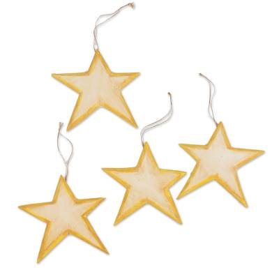 Wood ornaments, 'Yellow Stars' (set of 4) - Set of Four Wood Star Ornaments in Yellow from Bali