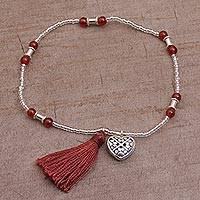Carnelian beaded stretch bracelet, 'Canine Soul' - Carnelian and Sterling Silver Paw Heart Bracelet from Bali