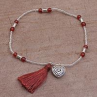 Carnelian beaded stretch bracelet, 'Canine Soul' - Carnelian and Sterling Silver Paw Heart Bracelet from Bali