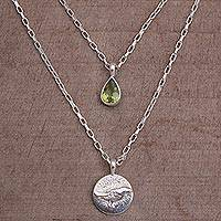 Peridot pendant necklace, 'Freedom Wings' - Peridot and Sterling Silver Bird Necklace from Bali