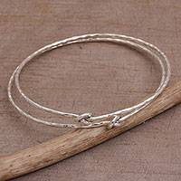 Sterling silver bangle bracelets, 'Why Knot' (pair) - Pair of 925 Sterling Silver Bangle Bracelets from Bali