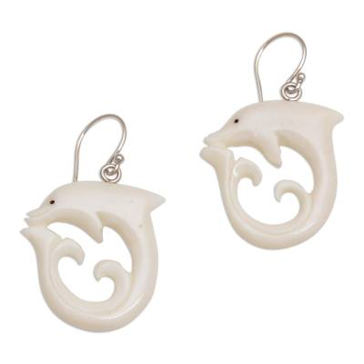 Bone dangle earrings, 'Dolphin Swirl' - Handcrafted Bone Dolphin Dangle Earrings from Bali