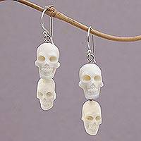 Bone dangle earrings, 'Trunyan Skulls' - Handcrafted Bone Skull Dangle Earrings from Bali