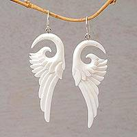 Bone dangle earrings, 'Swirling Wings' - Handcrafted Bone Wing-Shaped Dangle Earrings from Bali