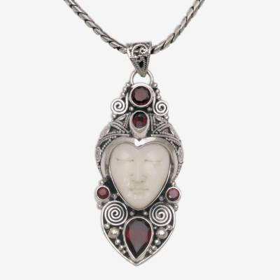 Garnet pendant necklace, 'Royal Knight' - Garnet and Sterling Silver Carved Pendant Necklace form Bali