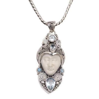 Blue topaz pendant necklace, 'Royal Knight' - Blue Topaz and Sterling Silver Carved Necklace from Bali