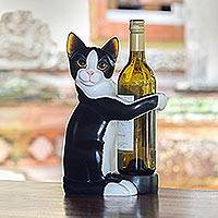 Wood wine bottle holder, 'Kitty Clasp' - Hand Carved Black and White Cat Figurine Wine Holder