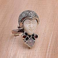 Rainbow moonstone and garnet cocktail ring, 'Honored Knight' - Rainbow Moonstone and Garnet Face Shaped Ring from Bali