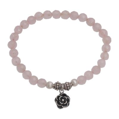 Rose quartz beaded stretch bracelet, 'Still Rose' - Rose Quartz and Flower Charm Beaded Bracelet from Bali