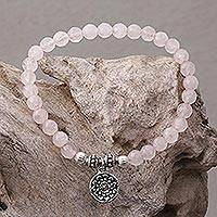 Rose quartz beaded stretch bracelet, 'Lotus View' - Rose Quartz and Floral Charm Beaded Bracelet from Bali