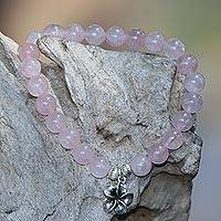 Rose quartz beaded stretch bracelet, 'Frangipani Love' - Rose Quartz Frangipani Flower Beaded Bracelet from Bali