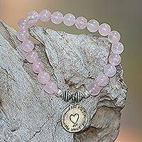 Rose quartz beaded stretch bracelet, 'Path to My Heart' - Rose Quartz Heart Charm Beaded Bracelet from Bali