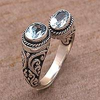 Blue topaz wrap ring, 'Dreamy Gaze' - Blue Topaz Wrap Ring Crafted in Sterling Silver in Bali