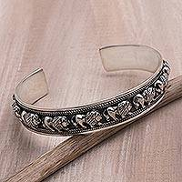 Sterling silver cuff bracelet, 'Lion Parade' - Sterling Silver Lion Motif Cuff Bracelet from Bali