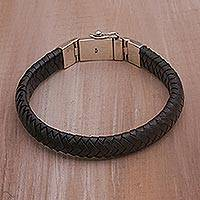 Leather wristband bracelet, 'Shrine Weave in Black' - Black Leather Braided Wristband Bracelet from Bali