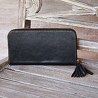 Leather clutch, 'Makassar Evening' - Handmade Black Leather Clutch Handbag with Tassel