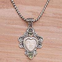 Peridot pendant necklace, 'Moonlight Warrior' - Peridot and Sterling Silver Face Necklace from Bali
