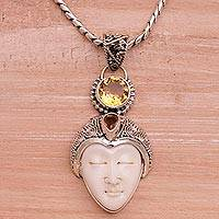 Citrine pendant necklace, 'The Chosen' - Citrine and Sterling Silver Face Pendant Necklace from Bali