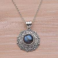 Labradorite pendant necklace, 'Frangipani Secrets' - Labradorite and Sterling Silver Pendant Necklace from Bali