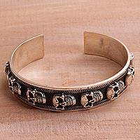 Men's sterling silver cuff bracelet, 'Fierce Skulls' - Men's Sterling Silver Skull Cuff Bracelet from Bali