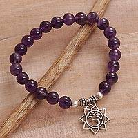 Amethyst beaded charm bracelet, 'Petaled Om' - Amethyst Floral Beaded Stretch Bracelet from Bali