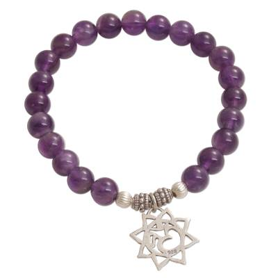 Amethyst beaded charm bracelet, 'Petaled Om' - Amethyst Floral Beaded Stretch Bracelet from Bali