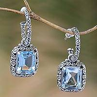 Blue topaz half-hoop earrings, 'Buddha Curl Memories' - Blue Topaz and 925 Sterling Silver Half Hoop Earrings