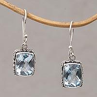 Blue topaz dangle earrings, 'Temple Gleam' - Blue Topaz and Sterling Silver Dangle Earrings from Bali