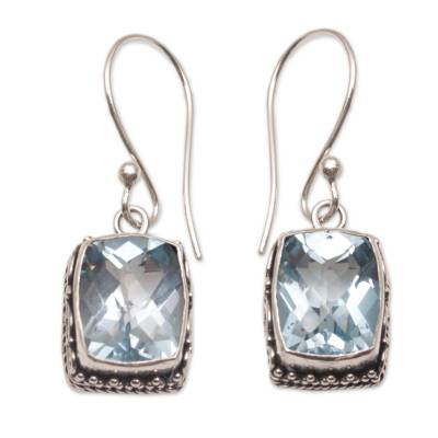 Blue topaz dangle earrings, 'Temple Gleam' - Blue Topaz and Sterling Silver Dangle Earrings from Bali