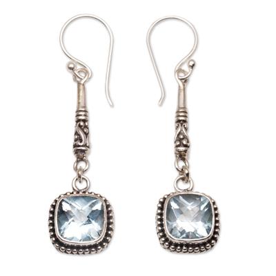 Blue topaz dangle earrings, 'Majestic Gleam' - Faceted Blue Topaz and 925 Silver Dangle Earrings from Bali