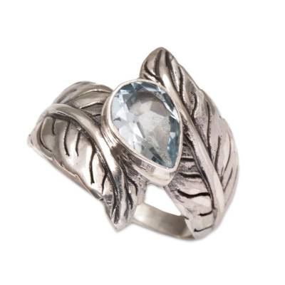 Blue topaz cocktail ring, 'Leafy Caress' - Blue Topaz and Sterling Silver Leaf Cocktail Ring from Bali