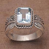 Blue topaz single stone ring, 'Razorleaf' - Blue Topaz Leaf-Themed Single Stone Ring from Bali