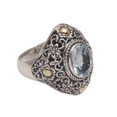 Gold accented blue topaz cocktail ring, 'Floral Mystique' - Gold Accent Blue Topaz Floral Cocktail Ring from Bali
