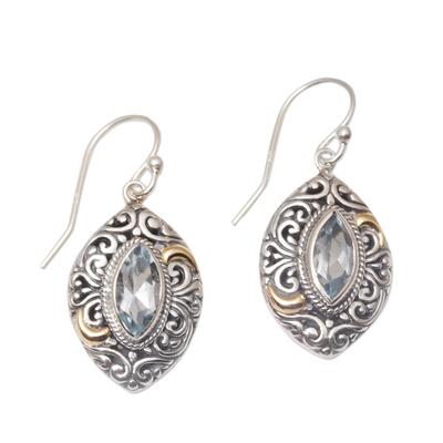 Gold-accented blue topaz dangle earrings, 'Defiant Beauty' - Gold-accented Blue Topaz Swirl Motif Dangle Earrings