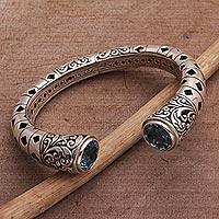 Blue topaz cuff bracelet, 'Borobudur Dew' - Blue Topaz and Sterling Silver Borobudur Motif Cuff Bracelet