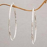 Sterling silver half-hoop earrings, 'Glimmering Memories' - Sterling Silver Hammered Motif Half-Hoop Earrings from Bali