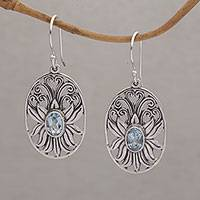 Blue topaz dangle earrings, 'Daylight Lotus' - Blue Topaz and Sterling Silver Lotus Dangle Earrings