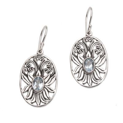 Blue topaz dangle earrings, 'Daylight Lotus' - Blue Topaz and Sterling Silver Lotus Dangle Earrings