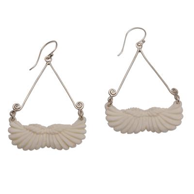Bone dangle earrings, 'Fly Home' - Bone and Sterling Silver Wing Dangle Earrings from Bali