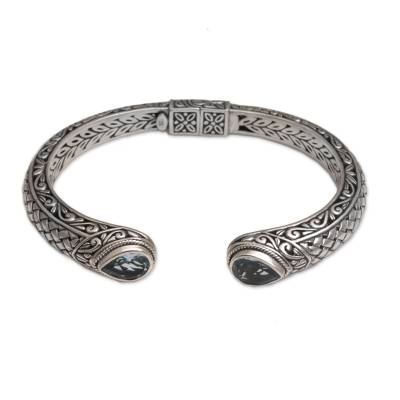 Blue topaz cuff bracelet, 'Blue Topaz Tears' - Blue Topaz and Sterling Silver Cuff Bracelet from Indonesia