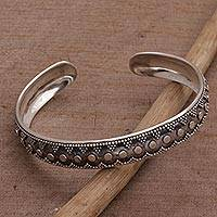 Sterling silver cuff bracelet, 'Shrine Bubbles' - Sterling Silver Circle Motif Cuff Bracelet from Bali