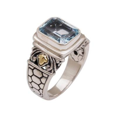 Gold accented blue topaz single stone ring, 'Blue Extravaganza' - Handmade Blue Topaz Single Stone Ring with Gold Accents