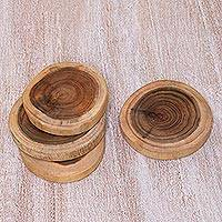 Teakwood coasters, 'Rings of Nature' (set of 4) - Set of 4 Artisan Hand-Carved Teakwood Coasters from Java