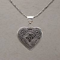 Onyx pendant necklace, 'Complex Heart' - Onyx and Sterling Silver Heart-Shaped Necklace from Bali