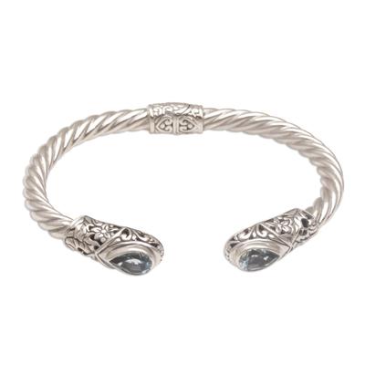 Blue topaz cuff bracelet, 'Floral Iridescence' - Blue Topaz and Silver Floral Cuff Bracelet from Bali